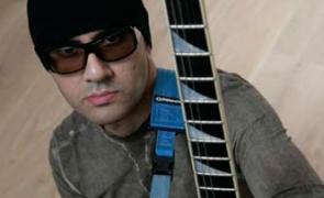 Dave Sharman with his blue checkerboard Jackson soloist custom